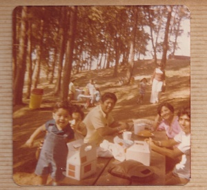 I am the baby in photo, with family having Pollo Campero.